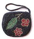 High fashion outsourcing agency supplies Elegant designer clutch purse in handcrafted beaded design with wrist strap